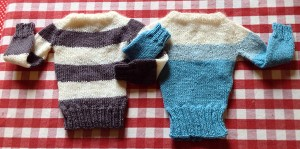 Two finished sweaters for my Etsy collection, grey and cream and cream and light blue striped.