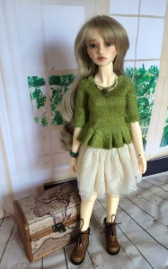 Heather wearing the second version of the green peplum over her lacy skirt