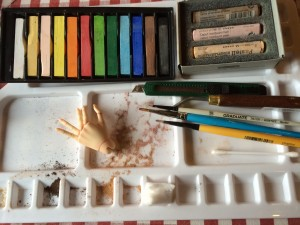 Mixing the pastels before brushing them on.