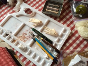Scraping the pastel with the knife and mixing the colours.