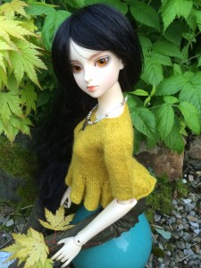 SD BJD Kimiko showing her yellow silk and alpaca peplum