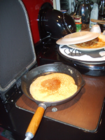 © Martine Moeykens -2007- Frying pancakes on the new Stanley range, Brandon, know to us as 'Ruby' -